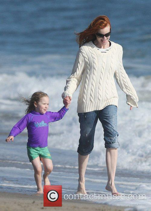 Marcia Cross playing games with her daughters on...