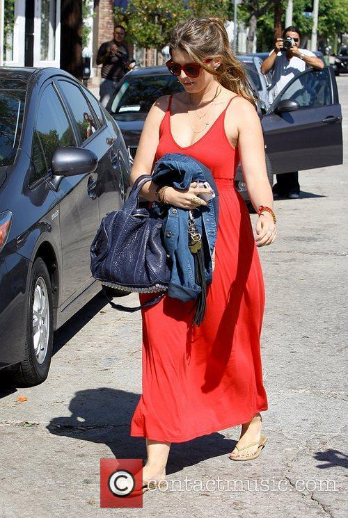 Arriving to meet her mother to go shopping...