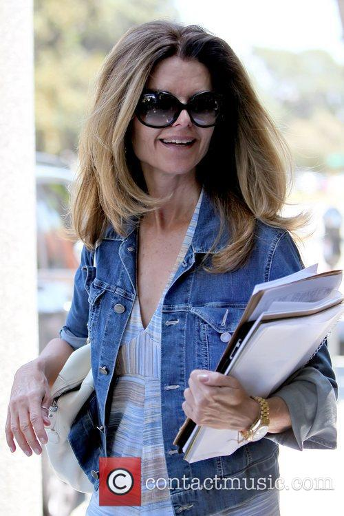 Maria Shriver smiling and in good spirits as...