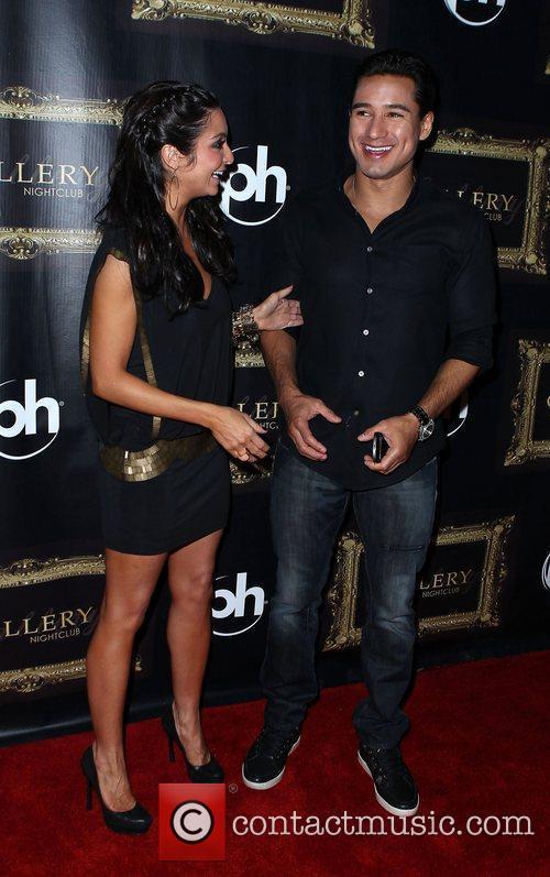 Courtney Mazza and Mario Lopez Mario Lopez celebrates...