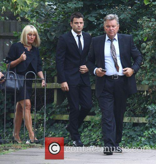 Appears at Redbridge Magistrates Court with his mother...