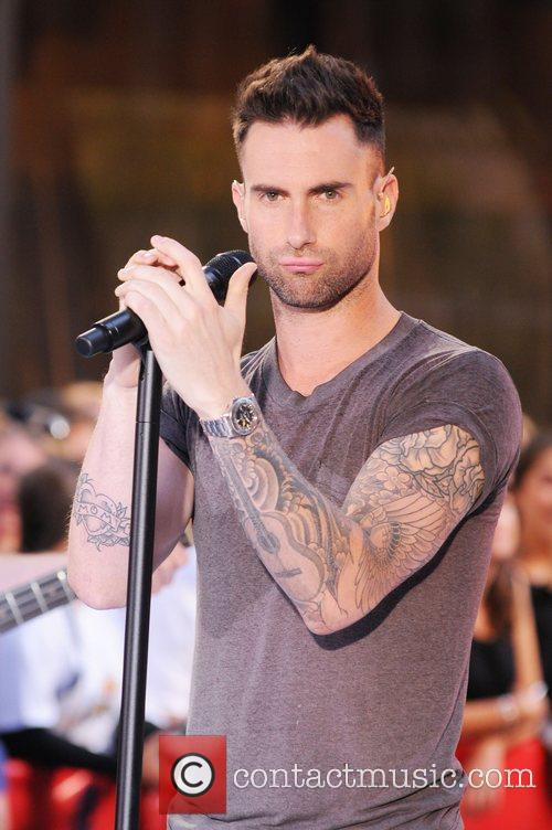 Maroon 5 performing live at Rockefeller Center as...