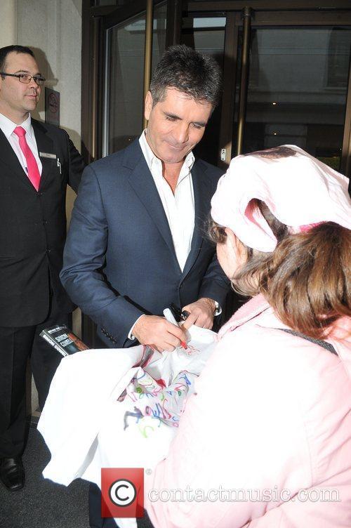 Simon Cowell with Celebrity hugger Tanya MacIntosh...