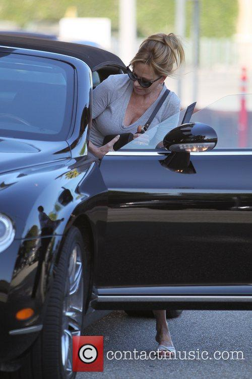 Melanie Griffith  leaving Saks Fifth Avenue department...