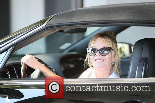 Melanie Griffith leaves Saks Fifth Avenue Beverly Hills...