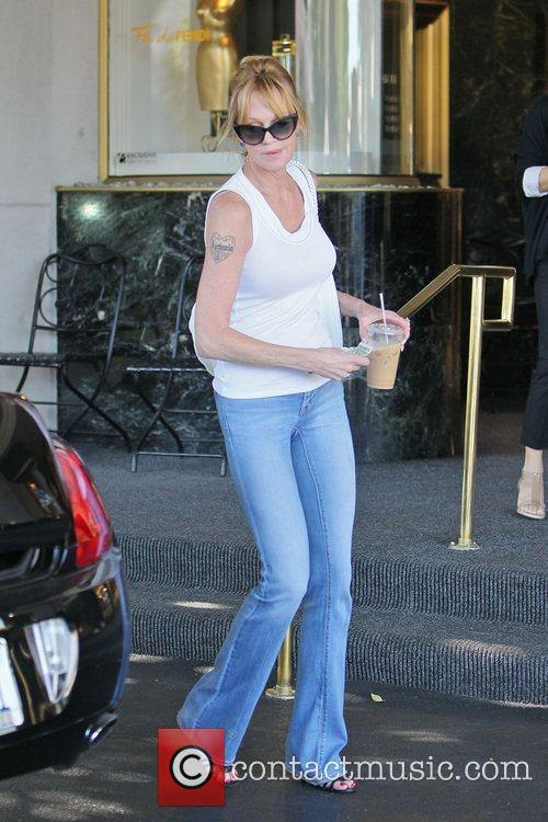 Showing off her slim figure in tight jeans,...