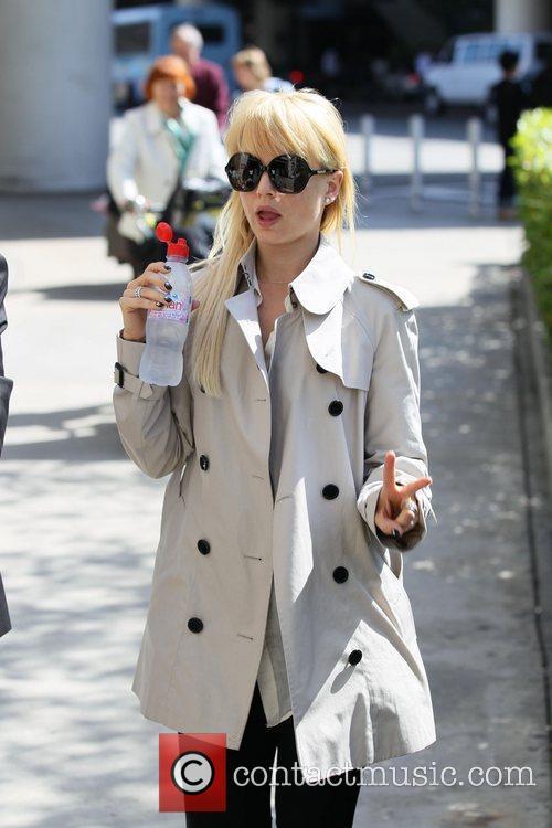 Mena Suvari arrives at LAX on an international...