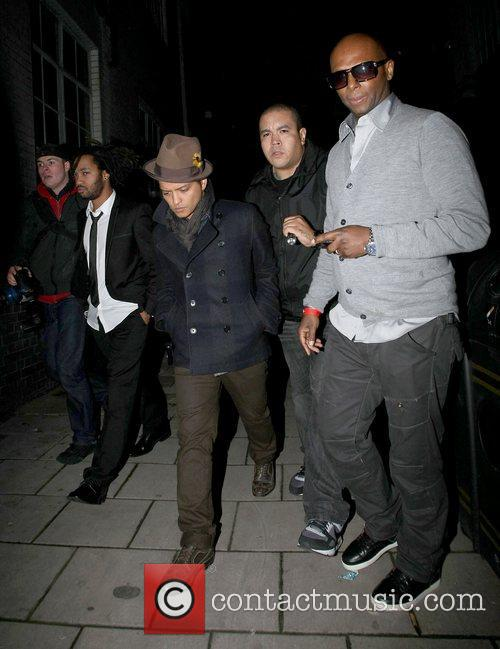 Bruno Mars trying to avoid the cameras as...
