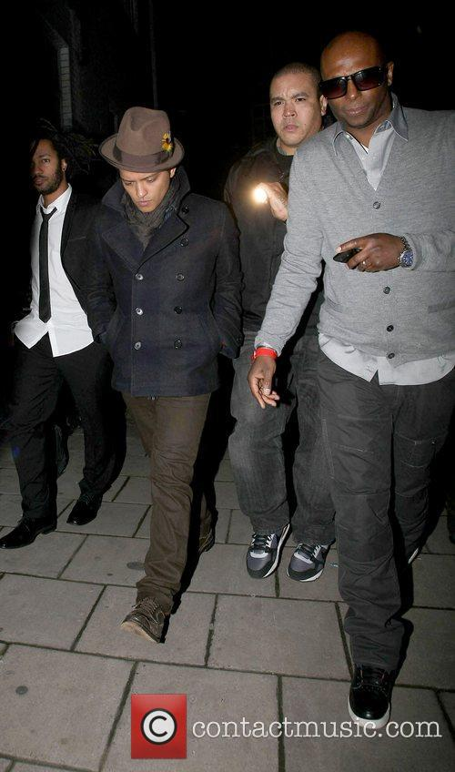 Trying to avoid the cameras as he arrives...