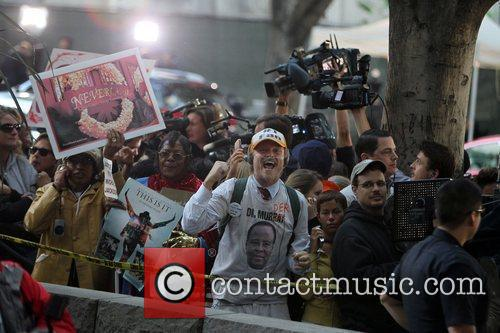 Fans outside the Los Angeles Superior Court, cheering...