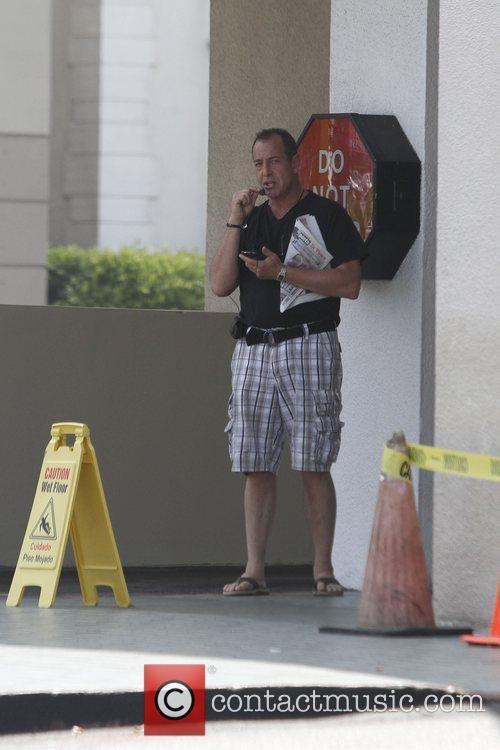 Michael Lohan is seen leaving McDonald's while chatting...