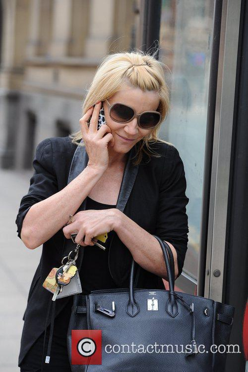Michelle Collins  out and about in Manchester...