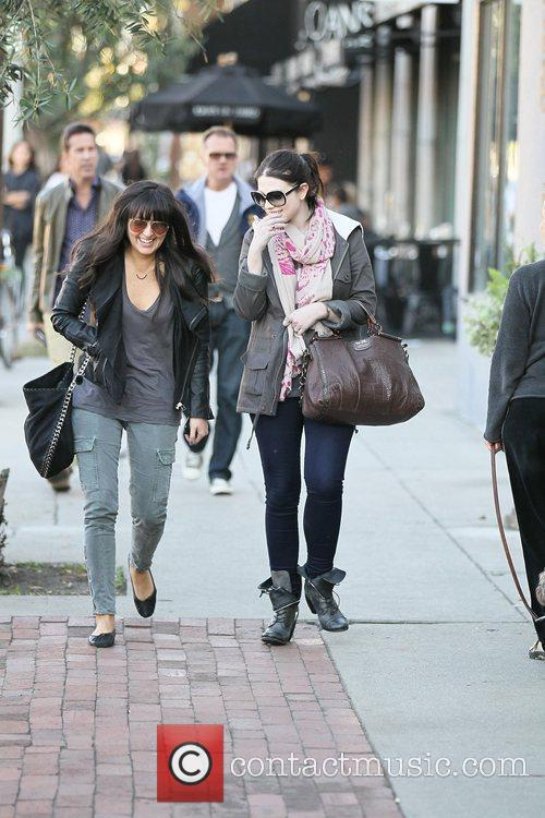 Michelle Trachtenberg walks with a female companion to...