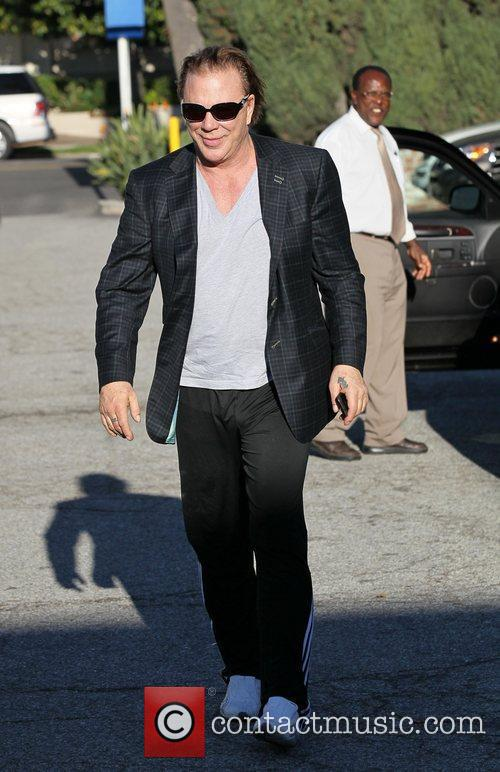 Mickey Rourke arrives to have his hair cut...