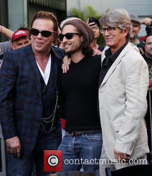 Mickey Rourke poses with Eric Roberts) and Roberts'...