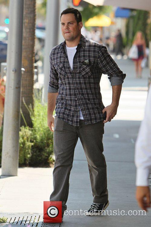 Mike Comrie  leaving Il Pastaio restaurant after...
