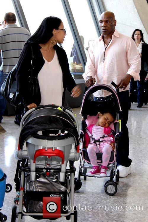 Mike Tyson and family at Dulles International Airport...