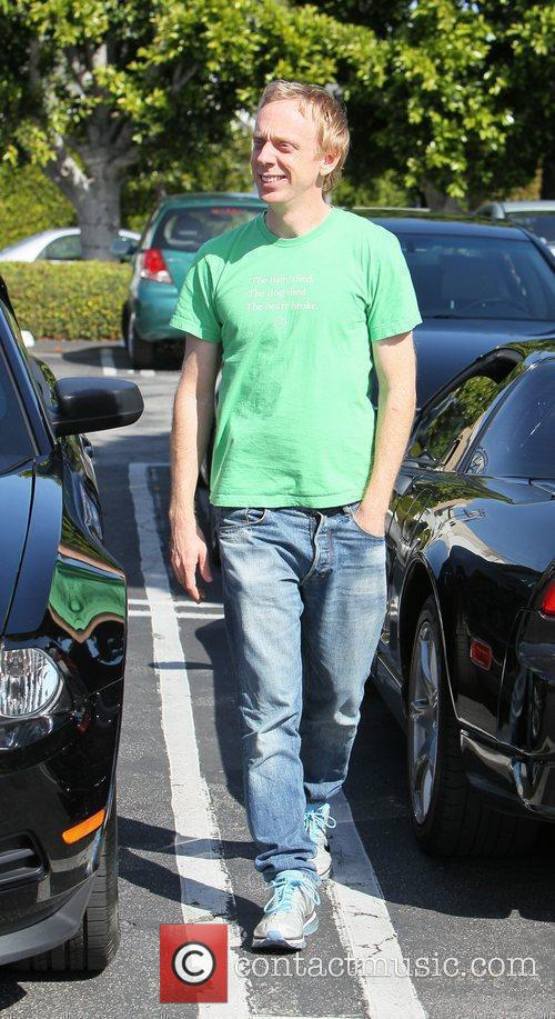 Mike White  walking in a parking lot...