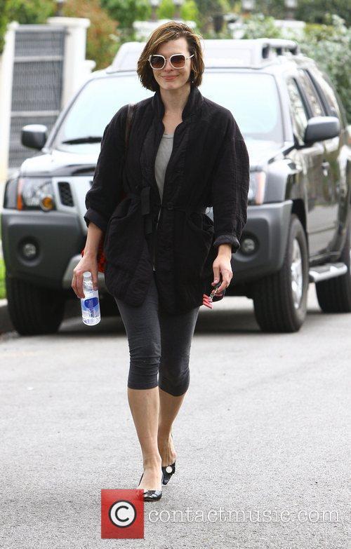 Milla Jovovich leaves the gym in short leggings...