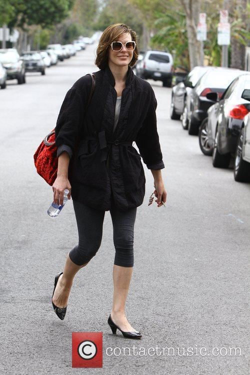 Milla Jovovich leaves the gym in short leggings...