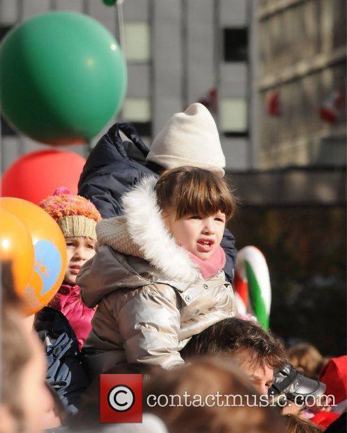 Milla Jovovich attends a festive Santa parade with...
