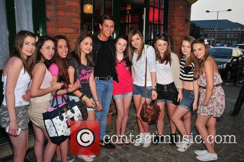 Joey Essex poses with fans Minnies Boutique launch...