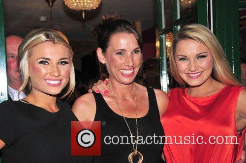 Billie Faiers and Sam Faiers (right) with their...