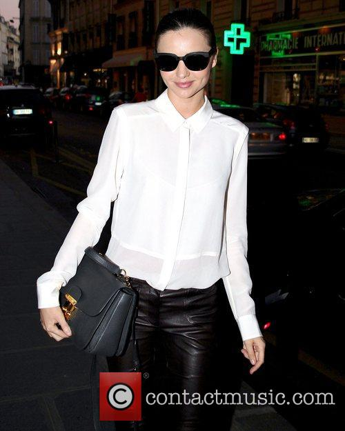 Miranda Kerr is all smiles as she arrives...