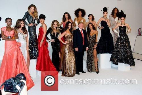 Donald Trump poses with former Miss Universe Winners...