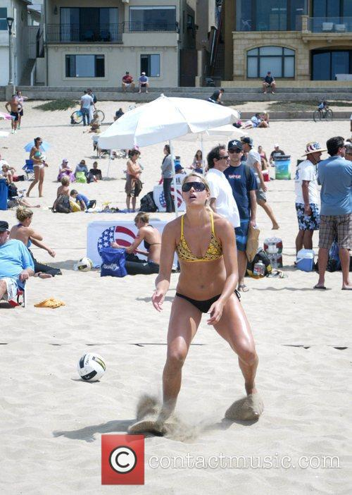 Plays volleyball on Manhattan Beach