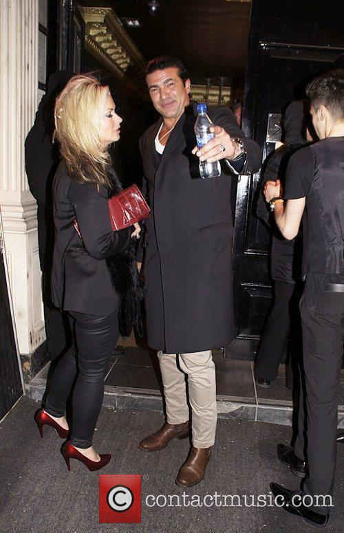 Tamer Hassan and guest leaving Movida nightclub...