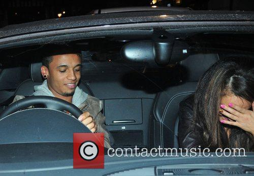 Aston Merrygold shys away as he arrives at...