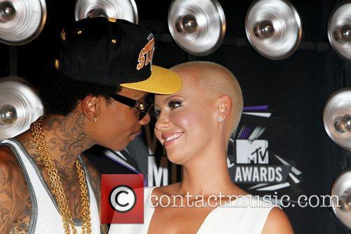 Amber Rose and guest 2011 MTV Video Music...