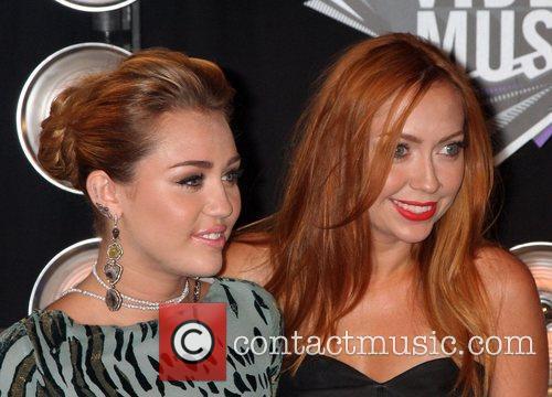 Miley Cyrus, sister  2011 MTV Video Music...