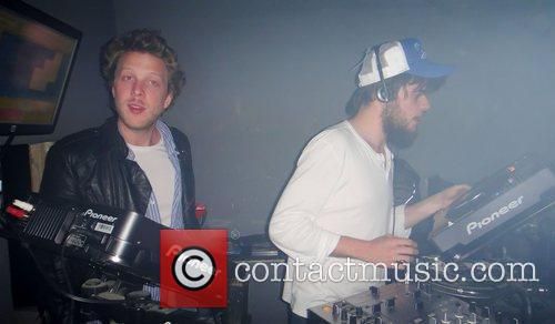 Band members of Mumford & Sons DJing at...