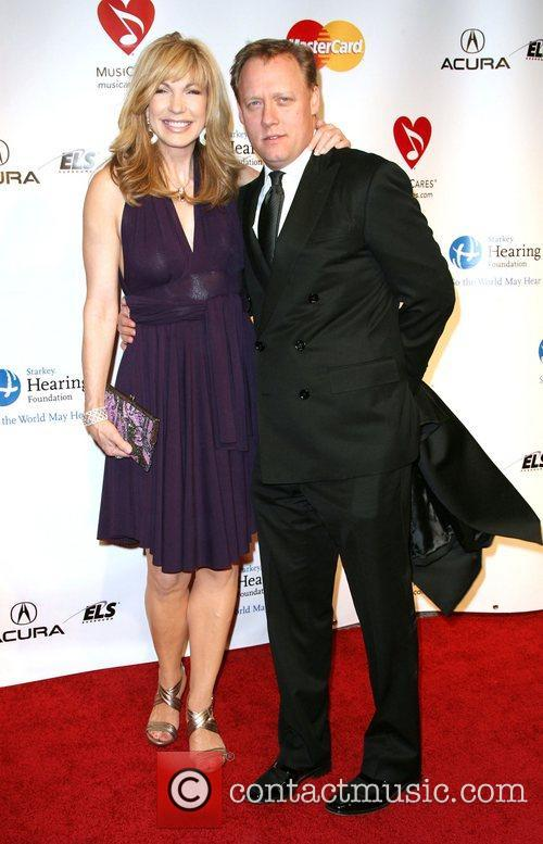 Leeza Gibbons and Guest 2011 MusiCares Person of...