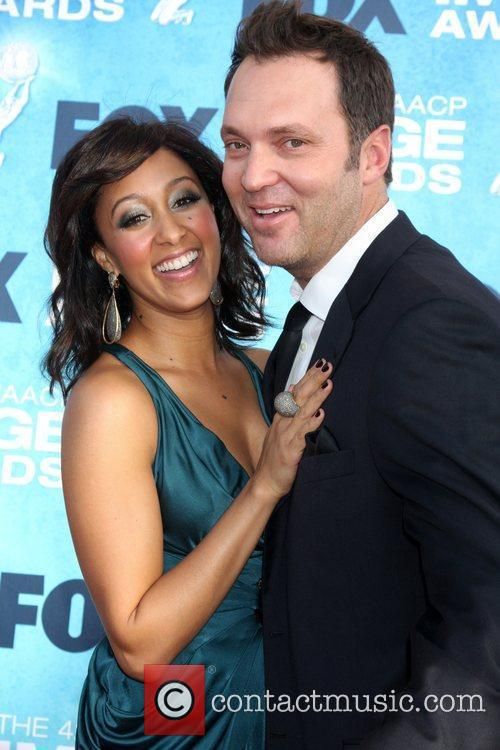 Tamara Mowry and Guest 42nd NAACP Image Awards...