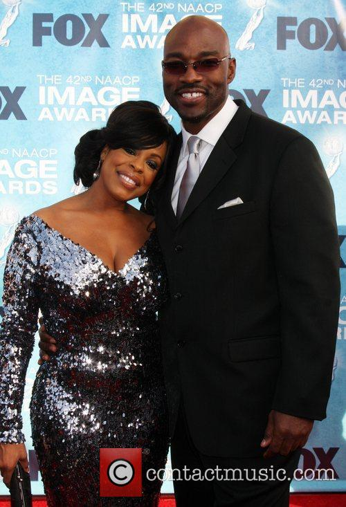 Niecy Nash and Guest 42nd NAACP Image Awards...