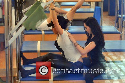 Nancy Dell'Olio endures a workout at the gym...