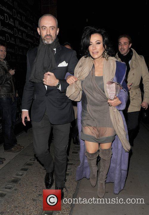 Nancy Dell'Olio and a male companion walking in...