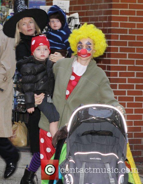 Naomi Watts and her children walking in Washington...