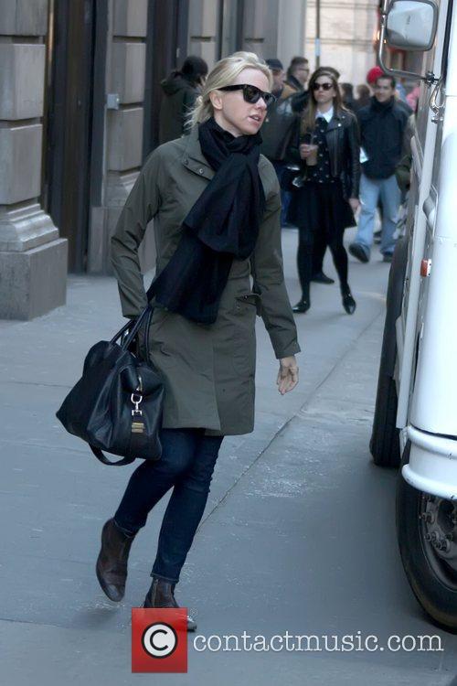 Walking in Soho carrying a large black bag