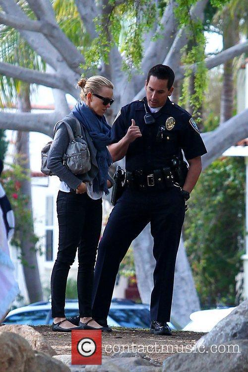 Naomi Watts speaking with a police officer after...