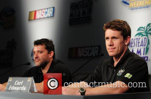 Carl Edwards (R), driver of the #99 Aflac...