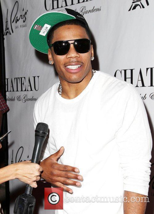 Nelly walks the red carpet at Chateau Nightclub...