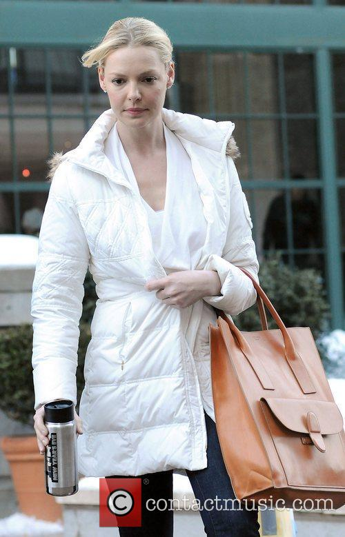 Katherine Heigl carrying a drinks flask on the...
