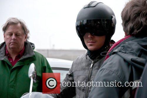 Zac Efron filming a stunt on a Vespa...