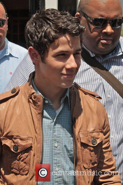 Nick Jonas arriving at The Grove to appear...