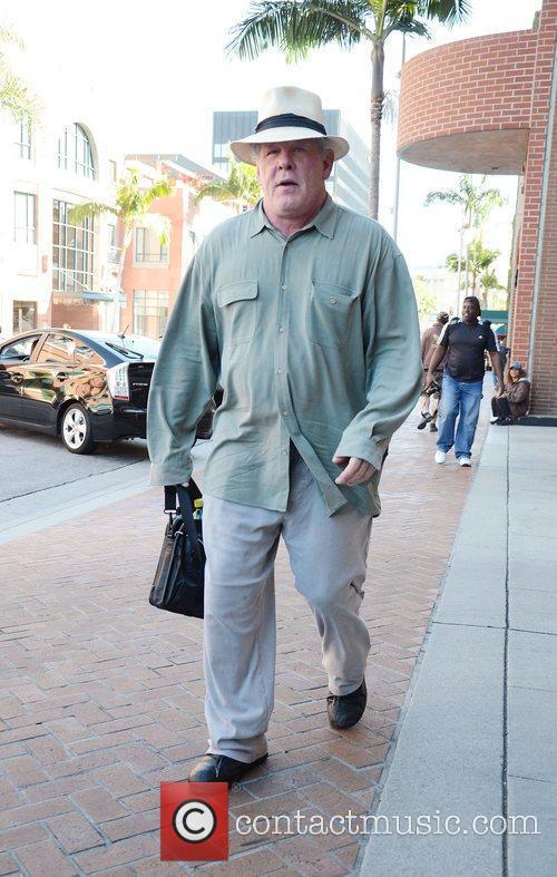 Nick Nolte wears a stylish Panama hat wile...