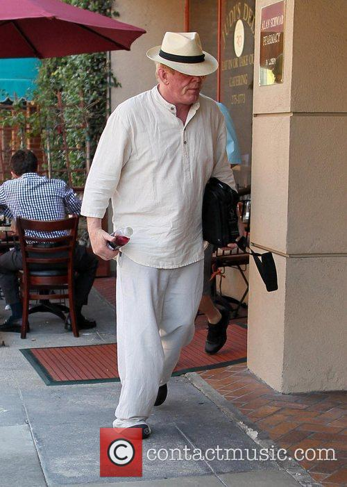 Nick Nolte, dressed in all white attire, visits...
